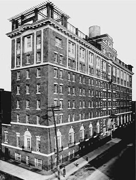 10 story block-like YWCA building on the corner of a New York street.