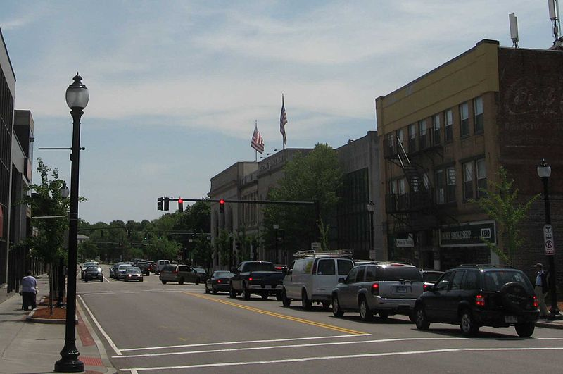 Cars stopped at a red light on a main street in a small town