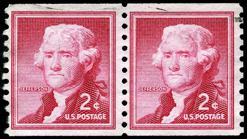 A double picture of a red 2-cent US stamp featuring a portrait of young Thomas Jefferson
