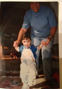 Nana holding toddler Andrew's hands as he walks