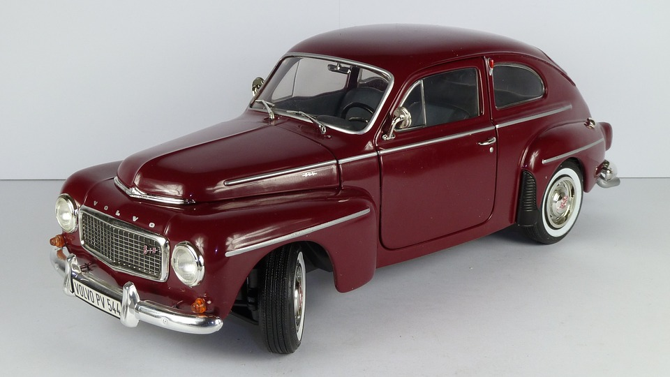 Model of a red Volvo sedan from 1958 tilted at an angle